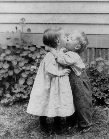 boy and girl kiss 1930s two children young boy and girl kissing posters boy girl kiss and