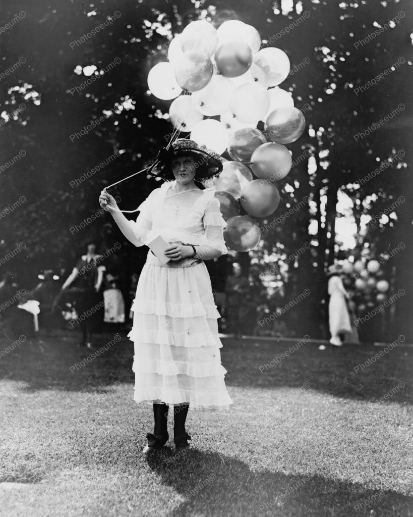 girl holding balloons colorado fine art documentary wedding and portrait photography balloons holding girl