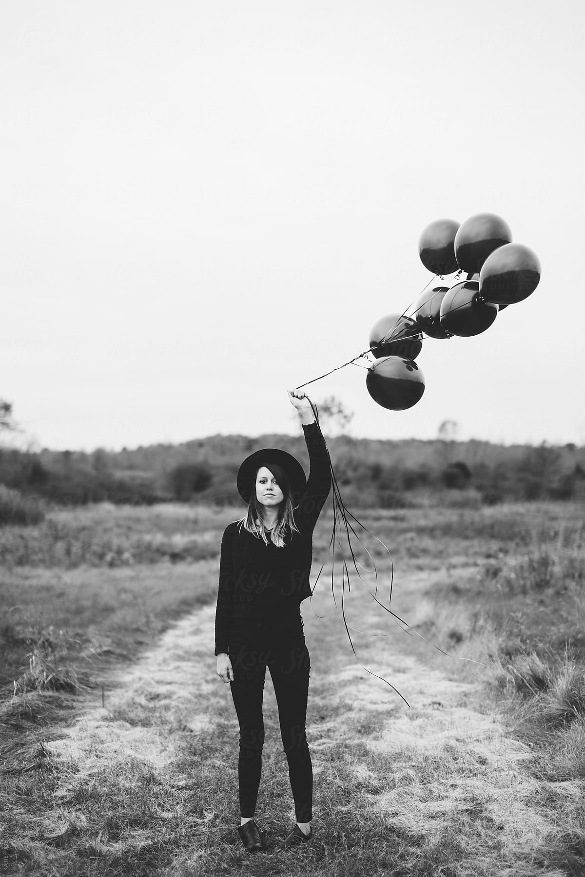 girl holding balloons westminster co documentary portraits molly and balloon holding girl balloons